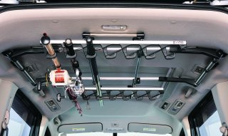 Inno IF4 fishing pole rack set up in SUV holding larger fishing rods in J-hook rod mounts